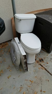 Toilet. like new just replaced with taller toilet