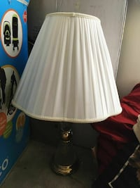 white and gold-colored table lamp