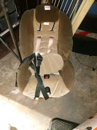 brown and black wooden rocking chair 302 mi
