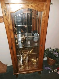 two lighted curio cabinets  Moore, 73170