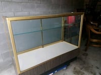 brown and white wooden display cabinet Jacksonville, 32216