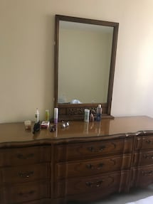 Brown wood 9 drawer dresser with mirror