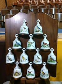 Porcelain Bell Collection  and wooden display rack Holmesville, 44633