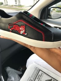 unpaired black and red Vans low-top sneaker Miami