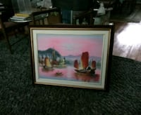 brown wooden framed picture of boats  542 km