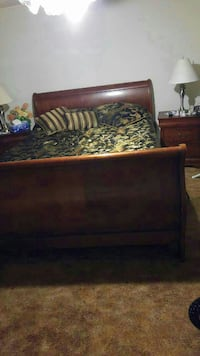 brown wooden sleigh bed