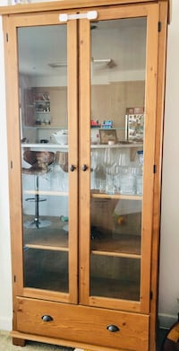 Brown wooden framed glass display cabinet. One glass rack is missing   Dublin, 94568