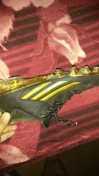 unpaired black and green cleat