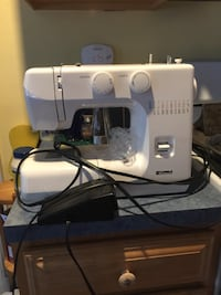 white and blue electric sewing machine Nelson, 03457