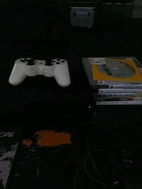 white Sony PS3 game console with controller Washington, 20001