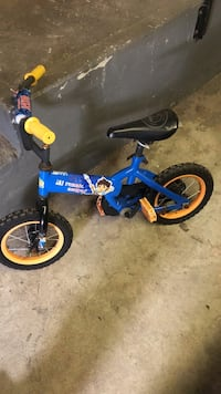 toddler's blue and black bicycle