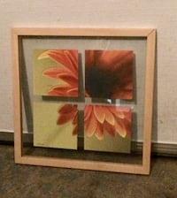 Brown wooden framed painting of red flower.