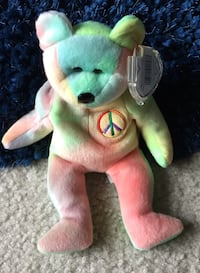 Green and white ty beanie baby bear plush toy