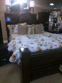 brown wooden bed frame with white and gray floral  Abilene, 79605