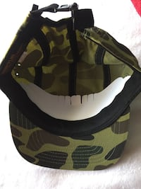 green and black camouflage Supreme cap Los Angeles, 90006