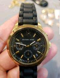 Black and gold Michael Kors watch.  Columbia, 21046