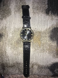 round silver analog watch with black leather strap Monona, 53716