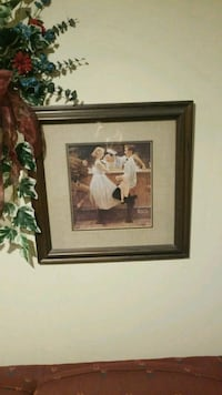 man and woman in front of bar table painting with brown wooden frame Dixon, 61021