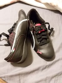 black-and-pink Puma lace-up shoes