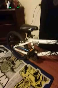 black white and blue full suspension bike Silver Creek, 30173