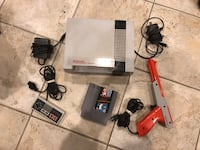 NES console with controller and game cartridge Montréal, H1E 6R7