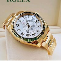 round gold-colored Rolex analog watch with link bracelet California