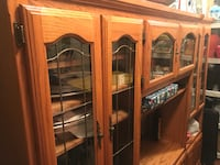 Brown wooden framed glass display cabinet
