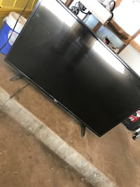 Black wooden tv stand with flat screen television Elgin, 60120