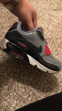 Paired black, gray, and red nike air max shoe Vero Beach, 32962