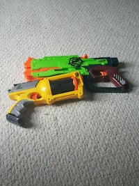 two yellow and green Nerf blaster toys