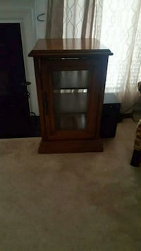 brown wooden framed glass cabinet Raleigh, 27614
