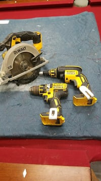 DeWalt circular saw and two cordless hand drills