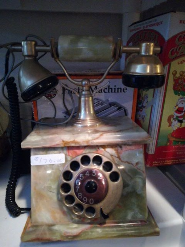 brown and gray cradle telephone