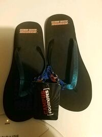 pair of black-and-blue flip flops Meridian, 83646