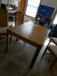 rectangular brown wooden table with four chairs di 380 mi