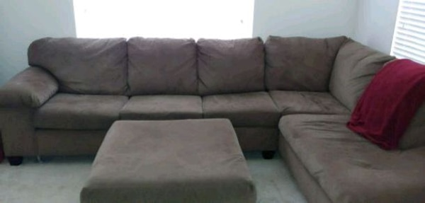 Tanish brown sectional sofa with ottoman