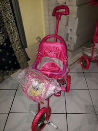 Brand new push tricycle for kids w sound and light interested only  Las Vegas, 89104