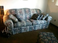 gray and blue floral fabric 3-seat sofa