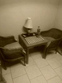 two brown wooden armchairs with coffee table Oklahoma City, 73127