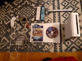 Wii 2 remotes a game all cords a censor with a joy stick
