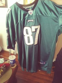 green and white NFL jersey shirt 68 km