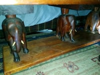 two brown wooden horse figurines