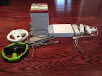 Nintendo Wii bundle includes console, 2 controllers, stand, 1 sensor, 1 nunchuck, 2 steering wheels, plus 18 wii games Markham, L3P 2T5