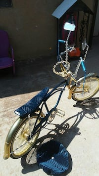 blue and gold monkey bicycle