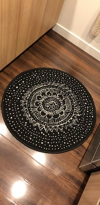 Round black and white ikea rug  Vancouver, V5R