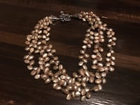 3 double strands of iridescent stones with great clasp