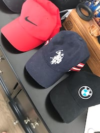 two black and red fitted caps Montréal, H8R 2M1