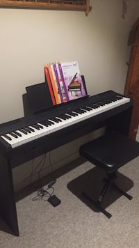 Yamaha Digital Piano 66 weighted keys with pedal and level 1-2-3 piano books Mississauga