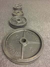 two black barbell plates and barbell null