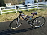 Pink and grey full suspension mountain bike Remington, 22734